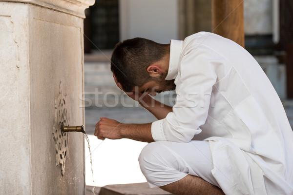 Islamic Religious Rite Ceremony Of Ablution Head Washing Stock photo © Jasminko