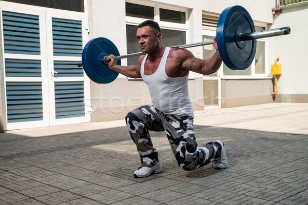 Gym Workout with Barbell Lunge Stock photo © Jasminko