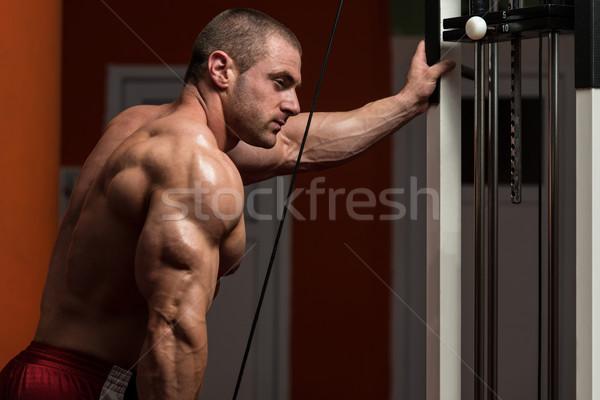 Muskularny człowiek ciężki masy wykonywania triceps Zdjęcia stock © Jasminko