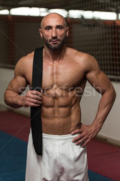 Sexy muskuläre Mann schwarz Gürtel Schulter Stock foto © Jasminko