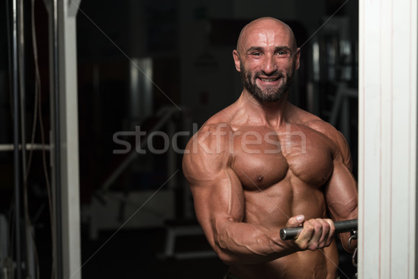 Mature Man Doing Exercise For Biceps Stock photo © Jasminko