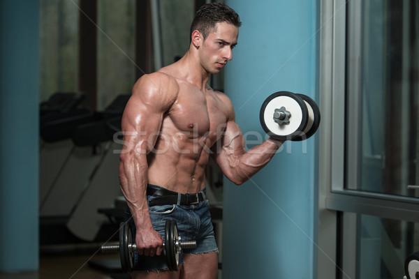 Moço bíceps concentração homem Foto stock © Jasminko