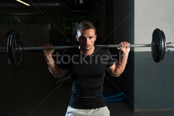 Young Man In Black T-Shirt Doing Barbell Squat Stock photo © Jasminko