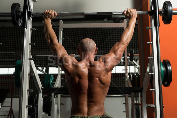 Bodybuilder Doing Heavy Weight Exercise For Shoulder Stock photo © Jasminko