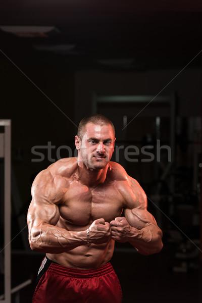 ストックフォト: ハンサム · ボディ · ビルダー · 筋肉の · ポーズ