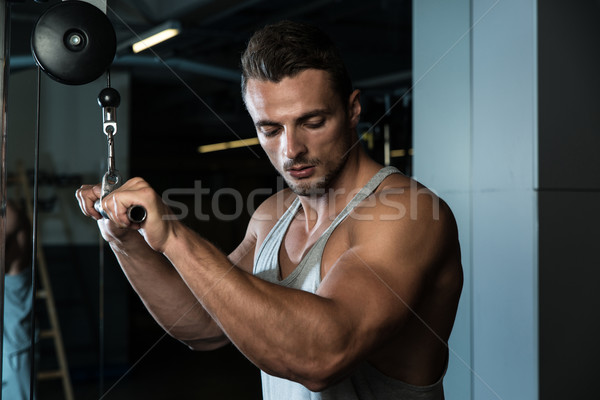 Bodybuilder Doing Heavy Weight Exercise For Triceps With Cable Stock photo © Jasminko