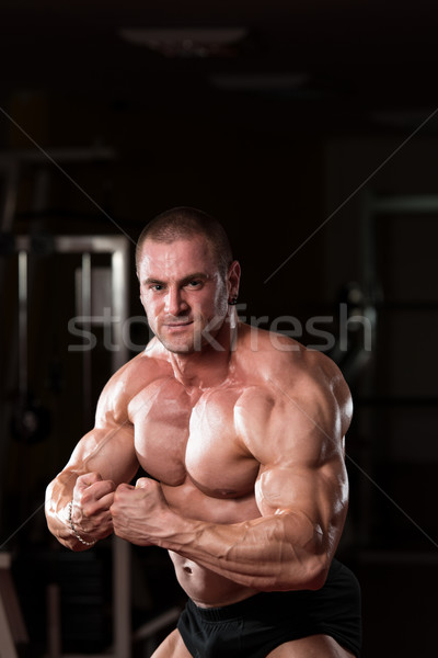 Young Bodybuilder Flexing Muscles Stock photo © Jasminko
