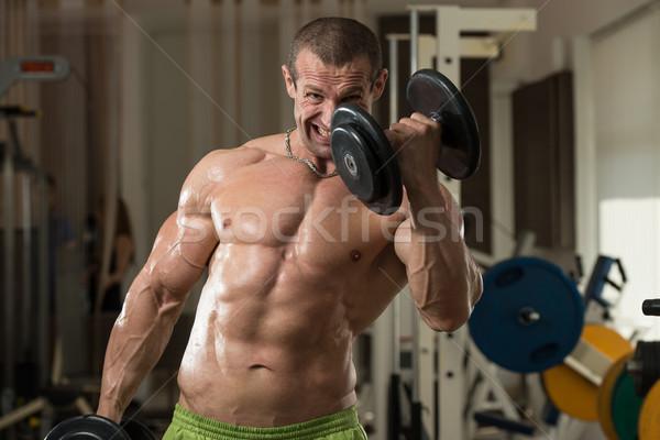 ボディービルダー 行使 上腕二頭筋 ダンベル 健康 ストックフォト © Jasminko