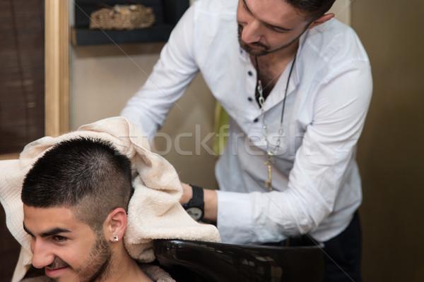 Smiling Man Having His Hair Washed At Hairdresser's Stock photo © Jasminko