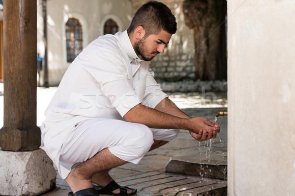 Islamic Religious Rite Ceremony Of Ablution Hand Washing Stock photo © Jasminko