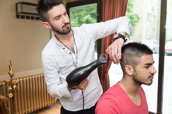 Hairdresser Blow Dry Man's Hair In Shop Stock photo © Jasminko