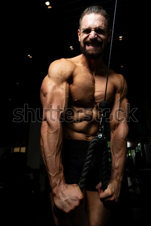 Sağlık genç vücut geliştirmeci kaslar siyah Stok fotoğraf © Jasminko