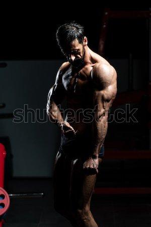 Musculaire homme triceps jeunes bodybuilder Photo stock © Jasminko