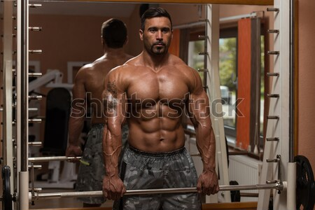 male bodybuilder resting after doing heavy weight exercise Stock photo © Jasminko