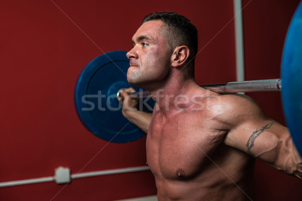 Body Builder doing squats with barbells Stock photo © Jasminko