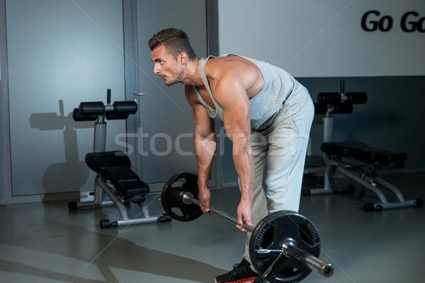 Man Performing Heavy Deadlift In A Gym Stock photo © Jasminko