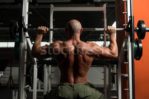Omuz egzersiz olgun adam spor salonu karanlık erkek Stok fotoğraf © Jasminko