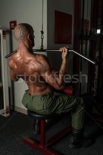 Saine homme mûr exercice Retour homme gymnase Photo stock © Jasminko