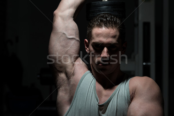 Man gymnasium triceps jonge Stockfoto © Jasminko