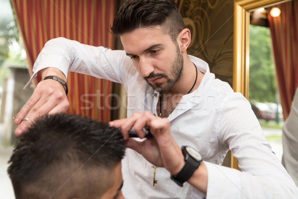 Hairdresser's Hands Cutting Hair Stock photo © Jasminko