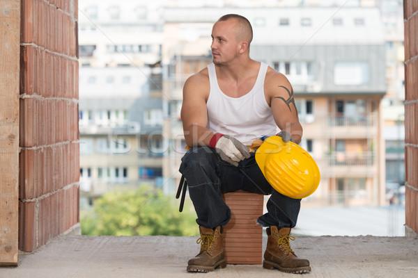 Tired Builder Resting On Brick Stock photo © Jasminko