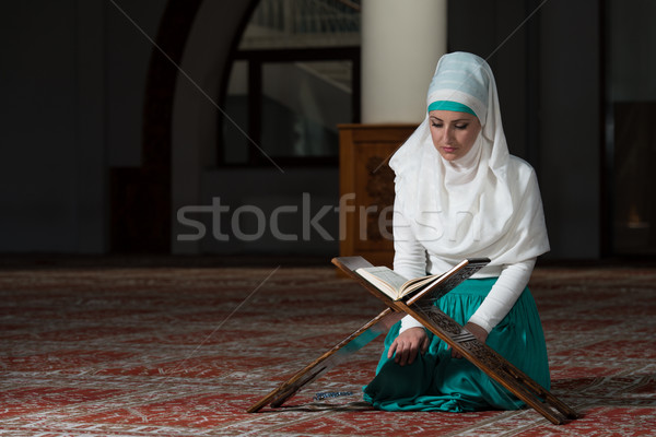 Stock photo: Muslim Woman Reading The Koran