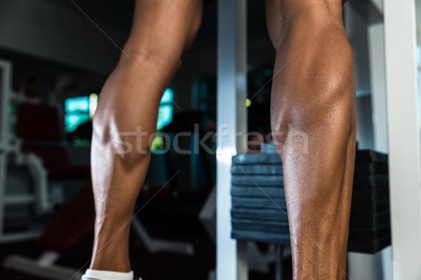 Izmos férfi vádli testmozgás bőr atléta Stock fotó © Jasminko