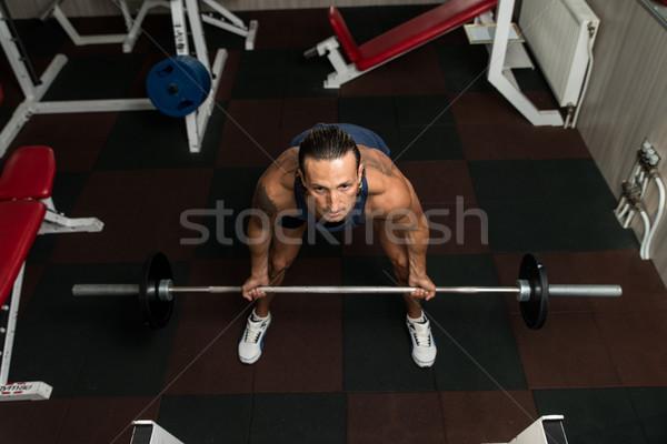 Barbell homem esportes corpo exercer Foto stock © Jasminko