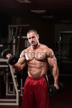 Mature Bodybuilder Exercising Biceps With Barbell Stock photo © Jasminko