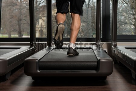 Stock photo: People running on treadmills