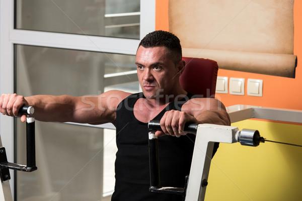 Effort banc presse exercice machine corps Photo stock © Jasminko