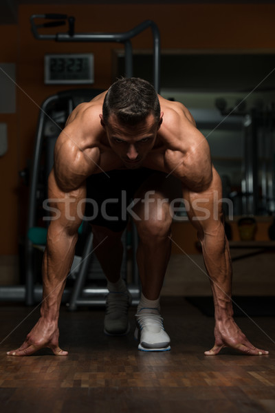 Strong Muscular Men Kneeling On The Floor Stock photo © Jasminko