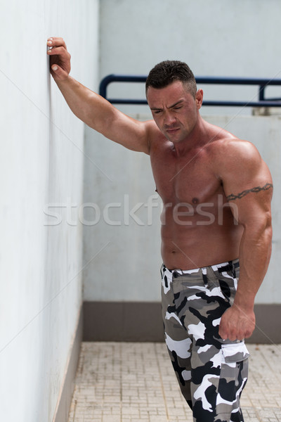 Portrait of muscular man resting Stock photo © Jasminko