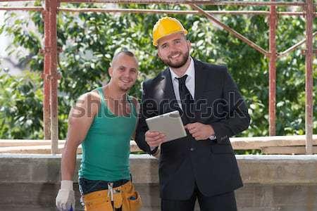 Empresário industrial trabalhador olhando grupo Foto stock © Jasminko
