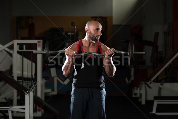 Dojrzały mężczyzna wykonywania sztanga biceps zdrowia Zdjęcia stock © Jasminko