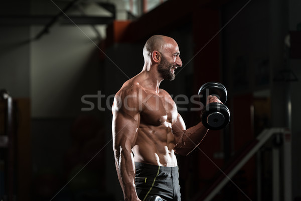Volwassen man oefening biceps gezondheid club Stockfoto © Jasminko