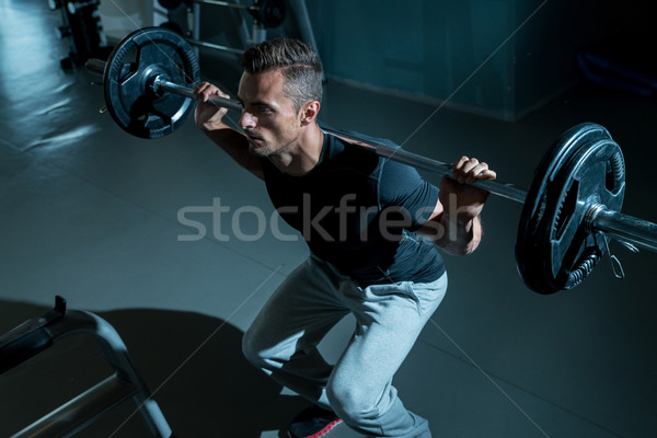 Man Working Out In A Gym Stock photo © Jasminko