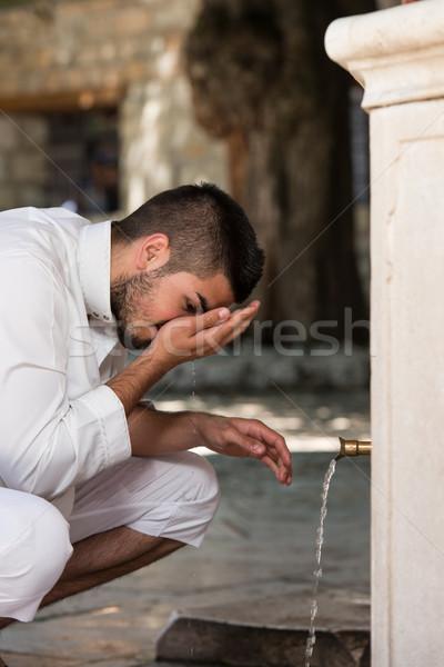 Islamic Religious Rite Ceremony Of Ablution Nose Washing Stock photo © Jasminko