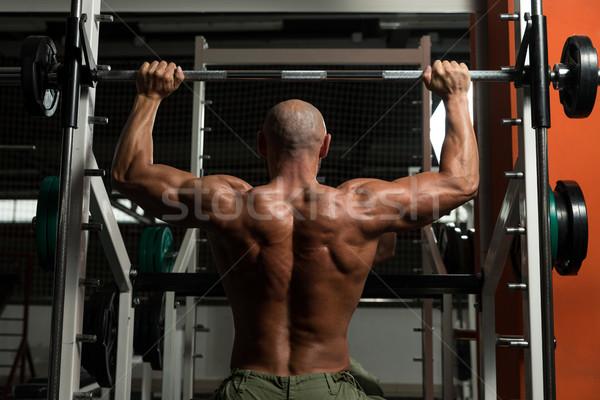 Saudável homem maduro exercer ombro ginásio escuro Foto stock © Jasminko