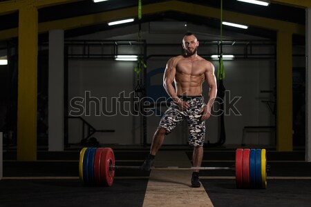 Muscular Bodybuilder Performing Cable Crossover Stock photo © Jasminko