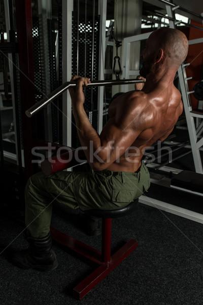 Olgun vücut geliştirmeci ağır ağırlık egzersiz geri Stok fotoğraf © Jasminko