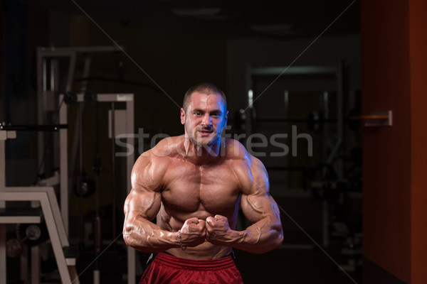 Handsome Body Builder Making Most Muscular Pose Stock photo © Jasminko