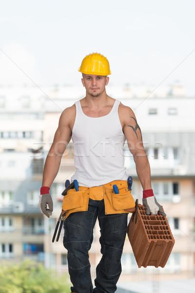 Trabalhar tijolo trabalhador engrenagem Foto stock © Jasminko
