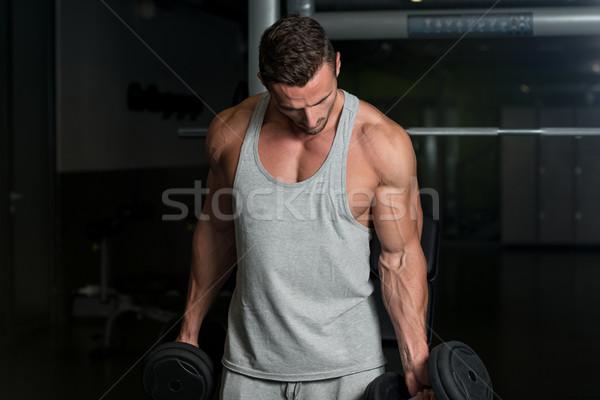 Young Muscular Man Lifting Weights Stock photo © Jasminko