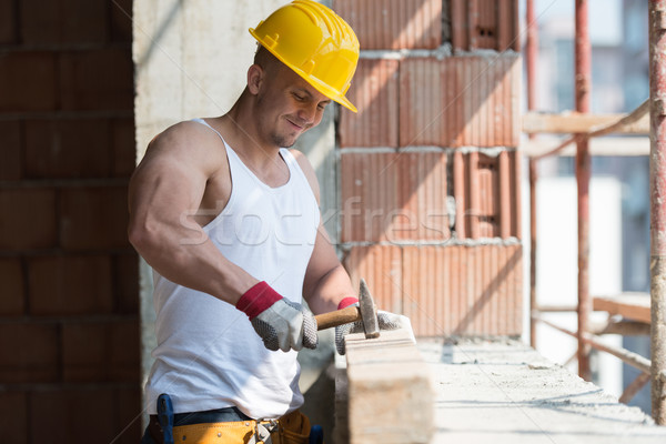 Construction Man Hitting Wood With Hammer Stock photo © Jasminko