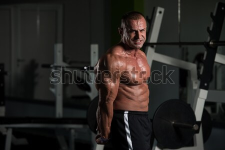 Maturité bodybuilder biceps homme mûr Photo stock © Jasminko