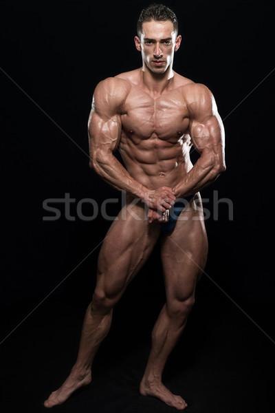 Yakışıklı vücut oluşturucu kas poz Stok fotoğraf © Jasminko