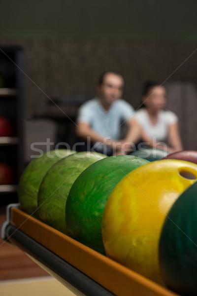 Beautiful Cheerful Couple Talking At The Bowling Alley Stock photo © Jasminko