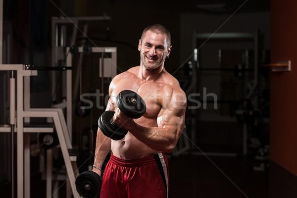 Bodybuilder Doing Exercise For Biceps Stock photo © Jasminko