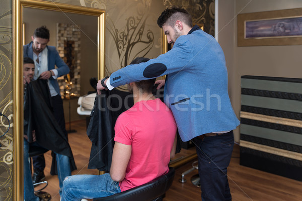 Young Hairdresser Making Preparation Before Giving A Haircut Stock photo © Jasminko